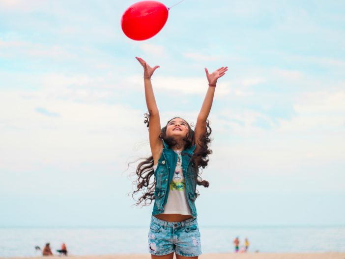 girl raising her hands